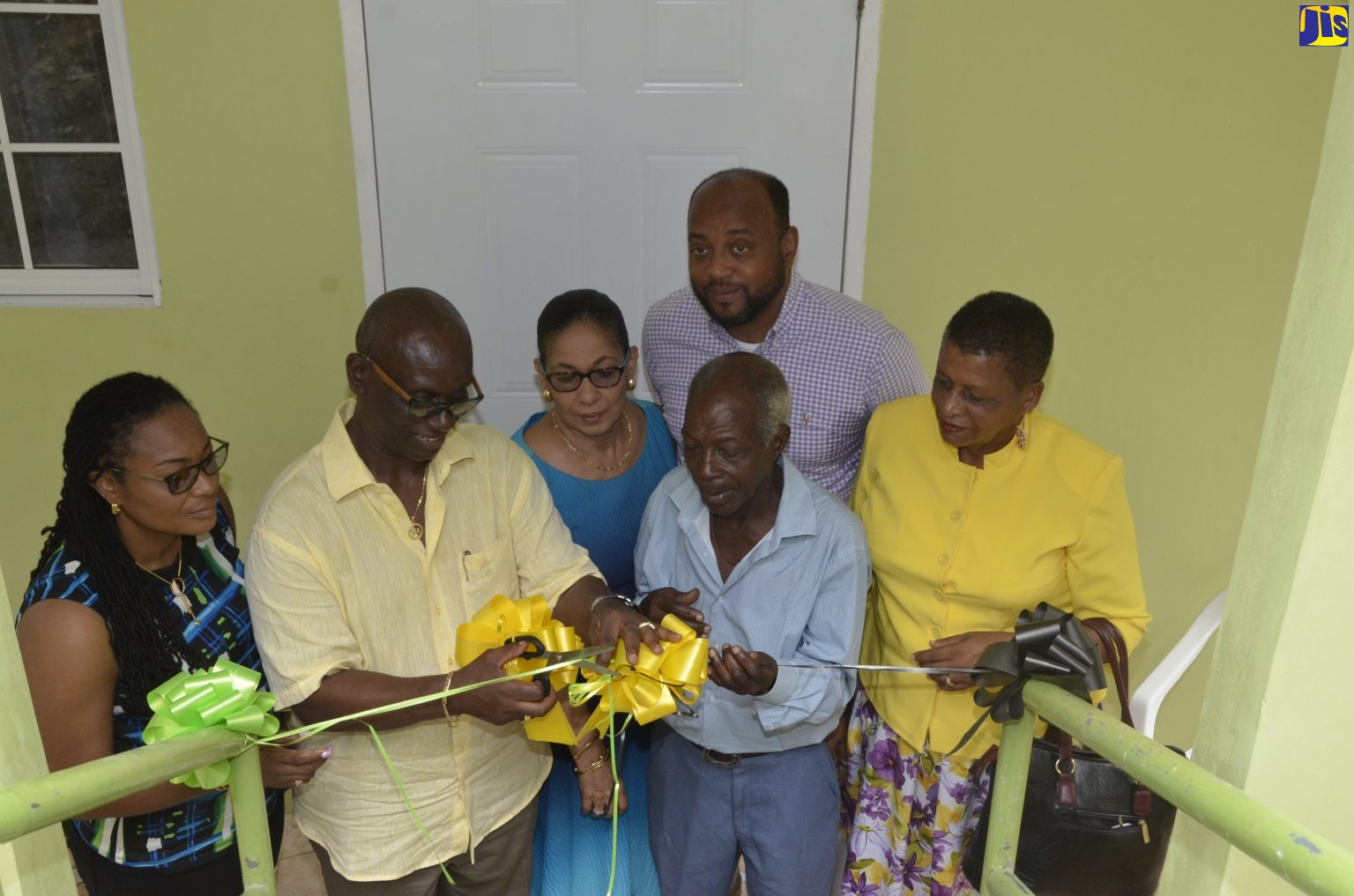 Minister presents St. Ann senior citizens with new homes