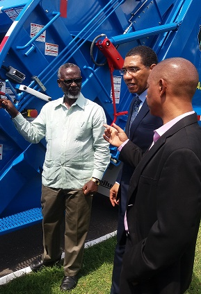 Ministry boosts NSWMA's fleet -Eleven new compactor trucks handed over to agency
