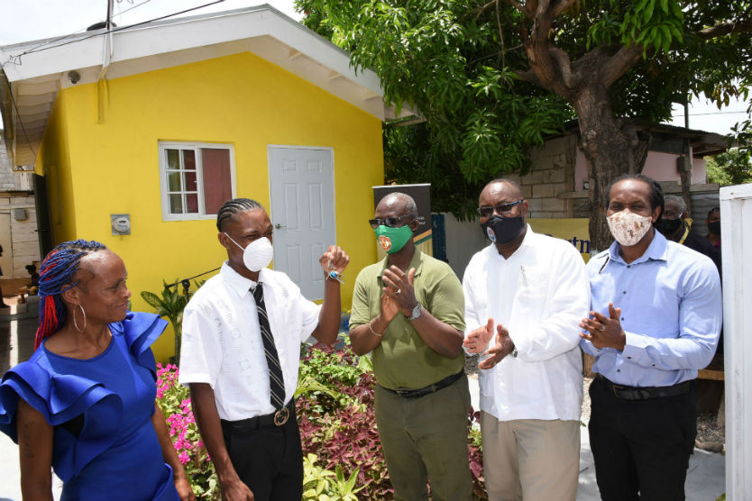 PHOTOS: Minister McKenzie Hands Over House to Raheem Powell